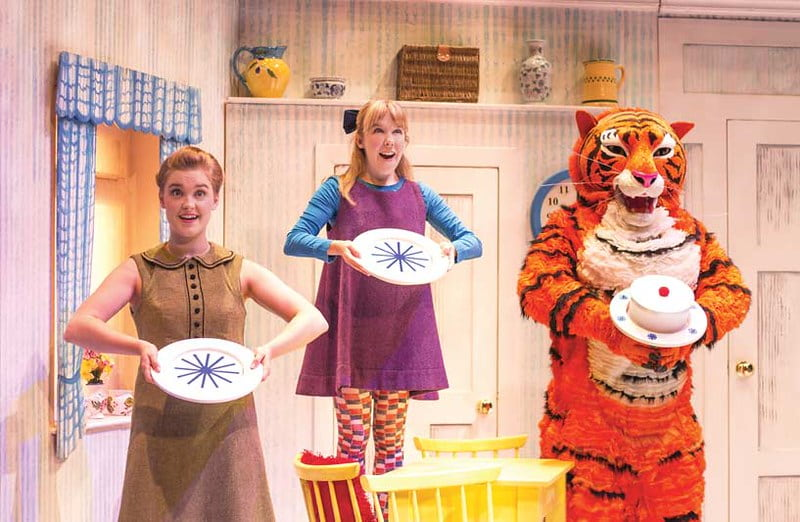 The cast of The Tiger Who Came to Tea performing a song on stage.