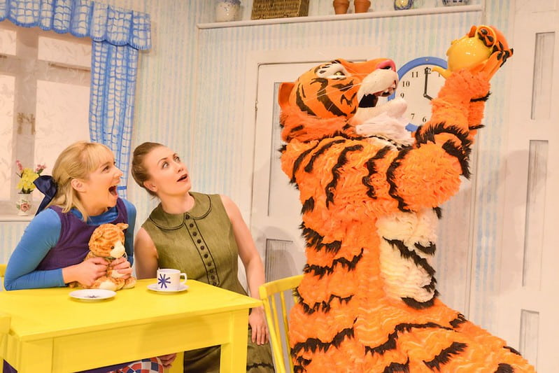 The Tiger Who Came to Tea drinking from a teapot on stage.