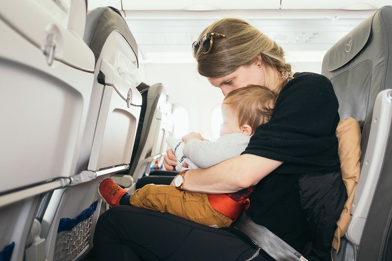 Mother With Baby On Plane playing