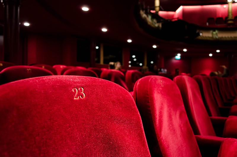 Close up of red theatre seats.