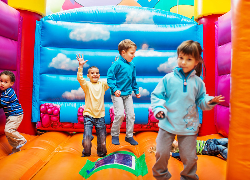 Group of children enjoying while playing in the bouncy castle