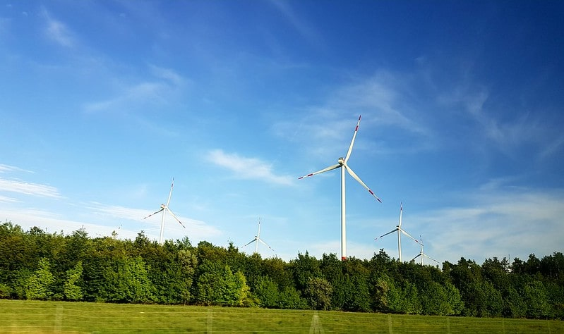 Wind turbines in the countryside generating sustainable, renewable energy.