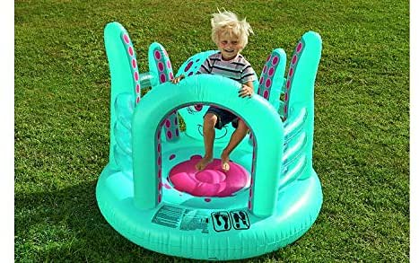 Child playing in turquoise octopus bouncy castle.