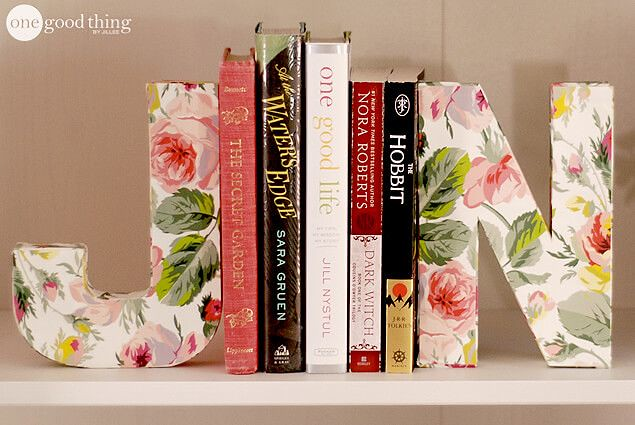 Big letters 'J' and 'N' in a floral design as bookends.