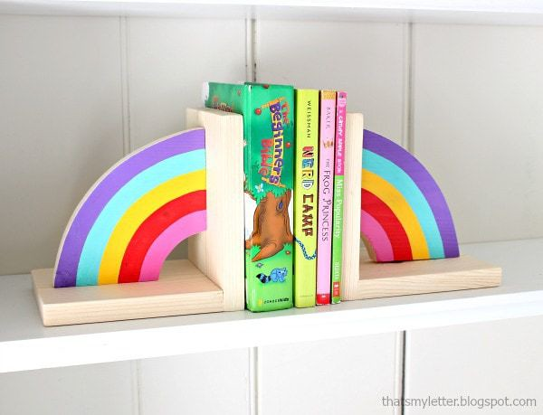 Each half of a rainbow as a bookend on either side of the books.