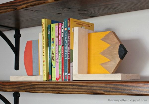 'To The Point' bookends - either half of a giant wooden pencil on each side if the books.