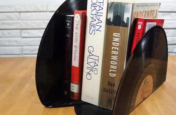 Records bent at a 90 degree angle to be used as bookends.
