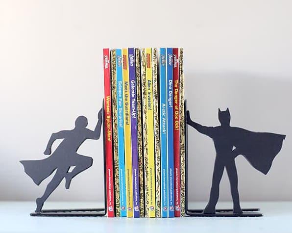 A shadow figurine of Superman and Batman on each bookend.