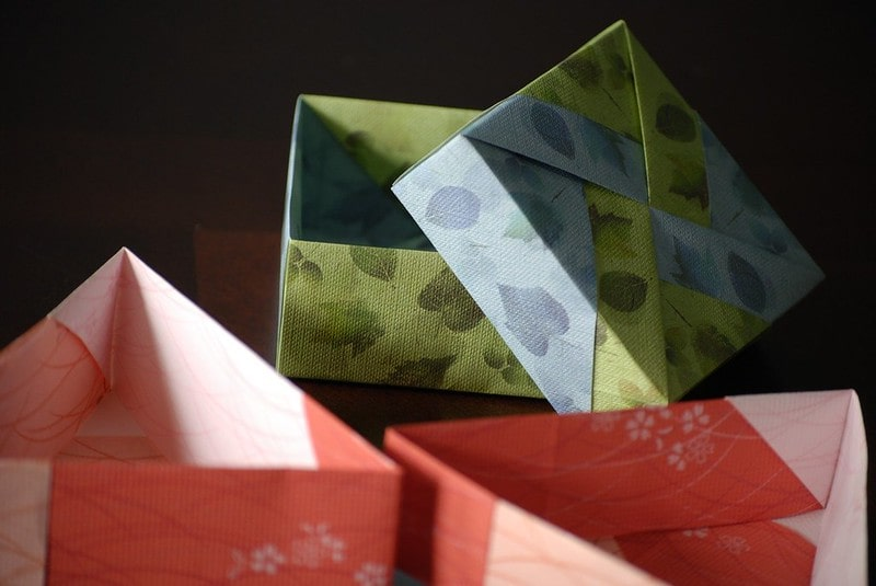 Origami gift boxes with their lids off.