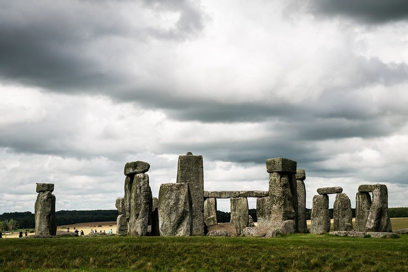 Stonehenge on a cloudy day with grey clouds above.