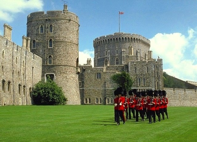 The resident regiment of Foot Guards performing the changing of the guard at Windsor Castle.