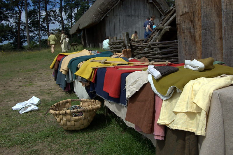 Iron Age clothing laid out on a table on display.