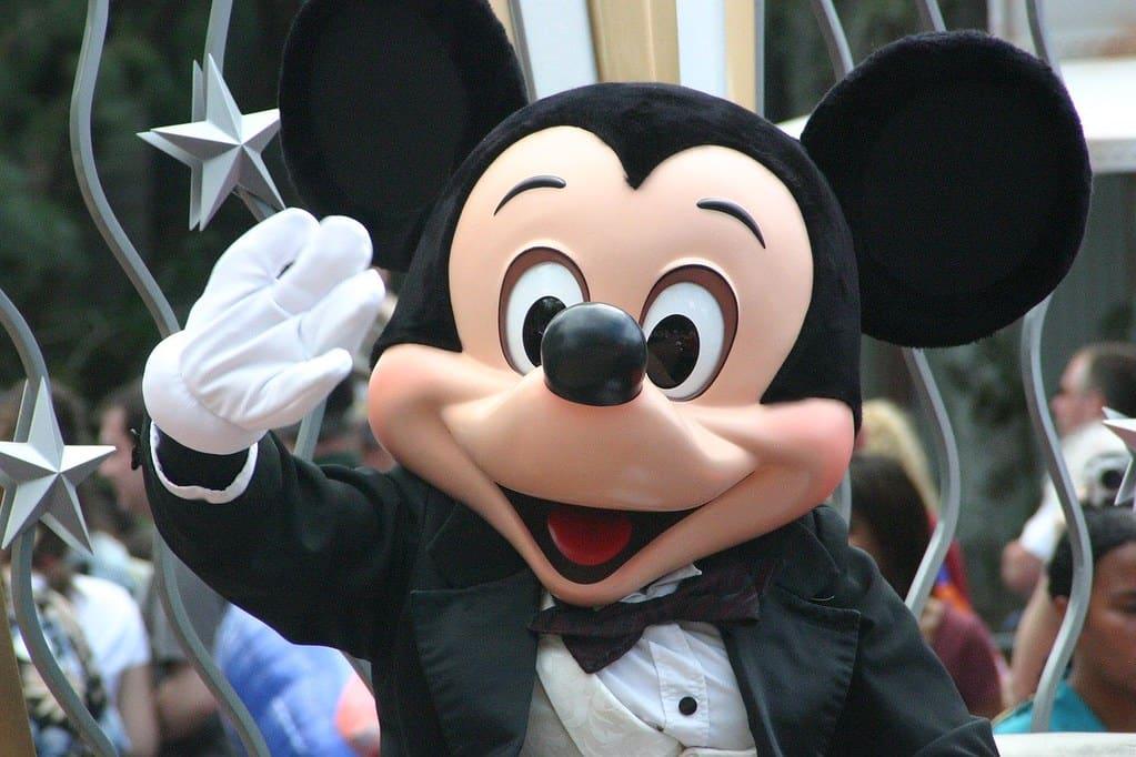 Mickey Mouse waving at Disneyland.