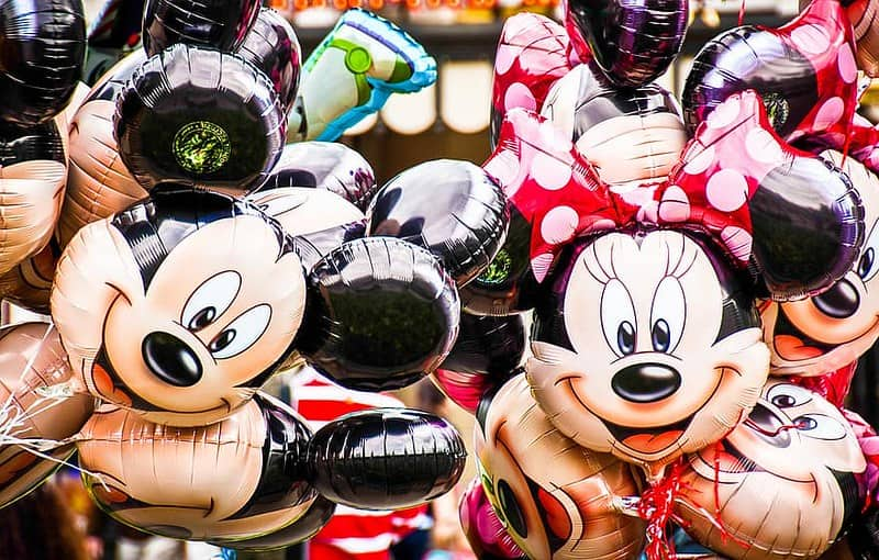 Disney balloons of Mickey and Minnie Mouse's faces.
