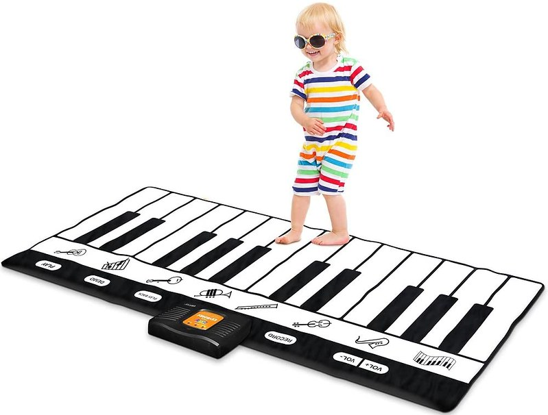Child playing on  NEWELL Playmat Keyboard.
