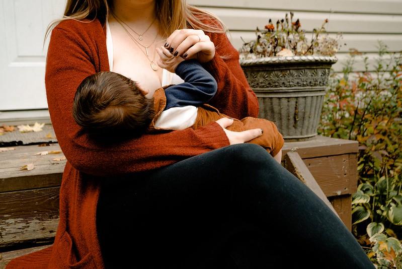 Mum breastfeeding her baby outside