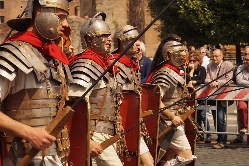 Roman soldiers marching forwards.