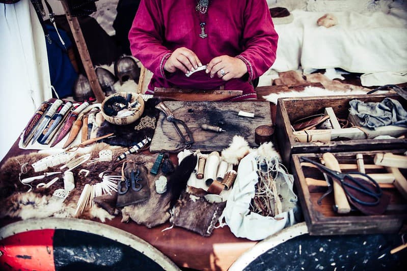 Woman behind a stall selling Viking accessories.