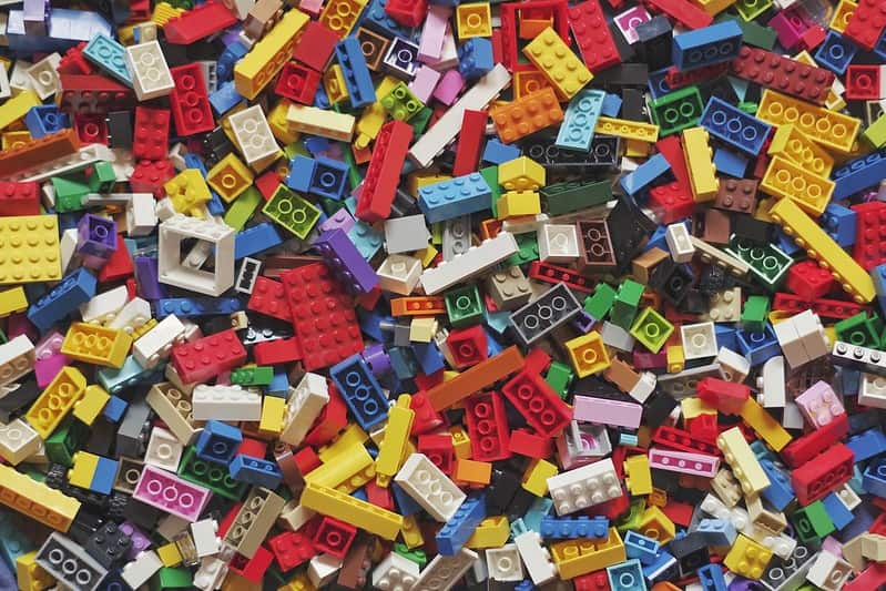 Lots of different coloured Lego pieces.