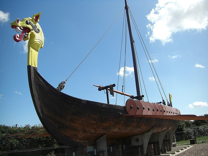 Reconstruction of a Viking longship with the head of a dragon at the mast.