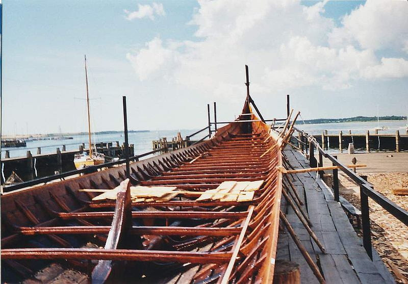 View of a Viking longship with the benches inside visible.