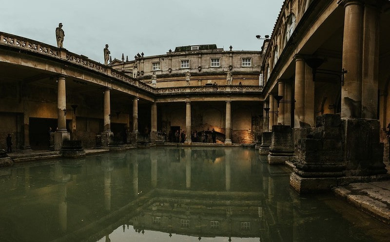 The main bath at the Roman baths, surrounded by a colonnade.