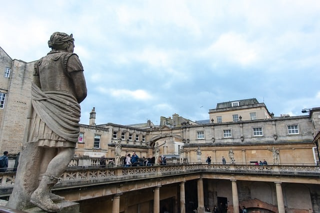 Statue on the top balcony of the Roman baths, overlooking the water.