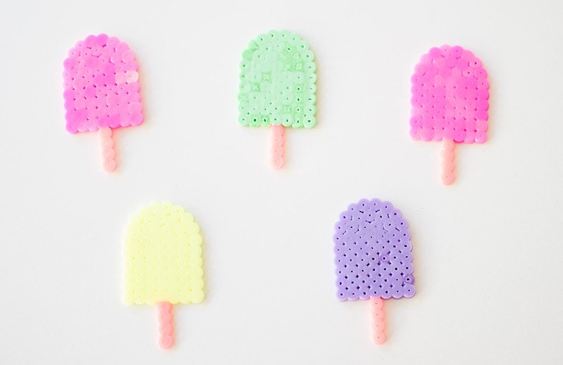 Colourful ice lollies made from Hama beads.