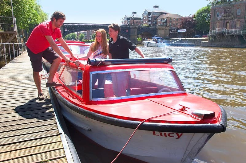 A couple and a skipper in the City Cruises York self-drive boat.