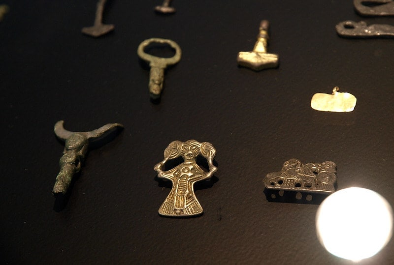 Viking amulets in a display cabinet.