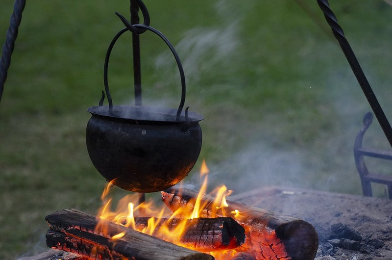 Viking cauldron pot hanging over a hot fire.