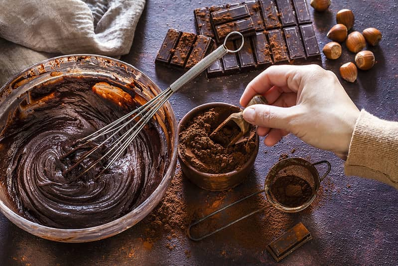 Person making chocolate at York's Chocolate Story.