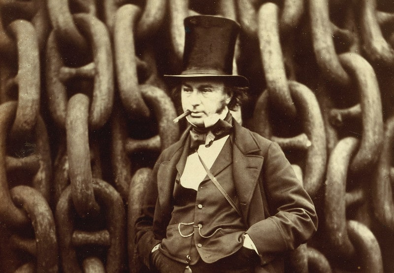 Black and white photograph of Isambard Kingdom Brunel, wearing a top hat and smoking.