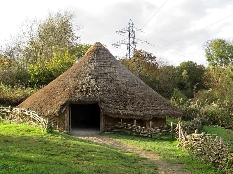 An Iron Age roundhouse with a pointed roof.