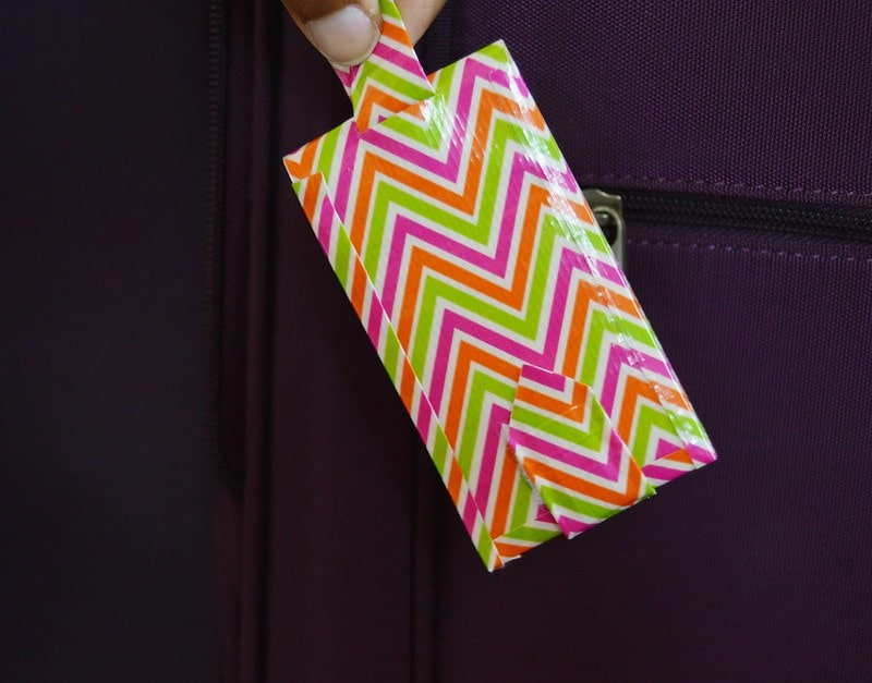 DIY luggage tag made from colourful, zig-zag tape.
