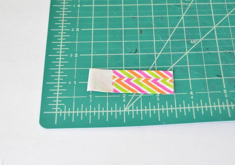 How to fold the tape to make a luggage tag.