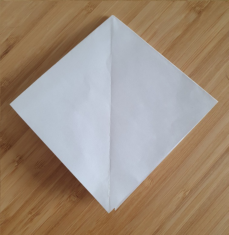 Step 1 to making an origami crow.