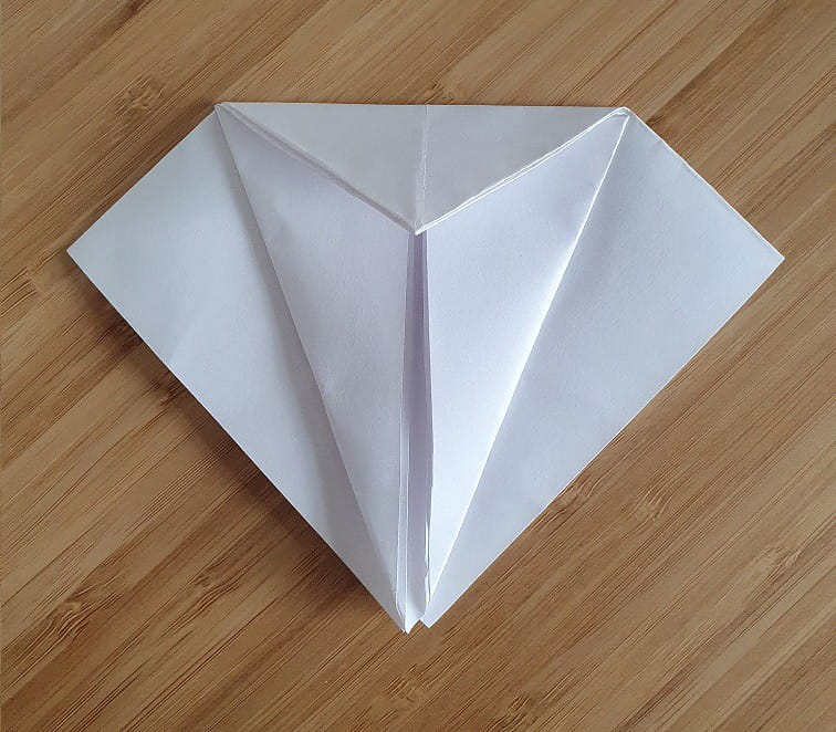 Step 2 to making an origami crow.
