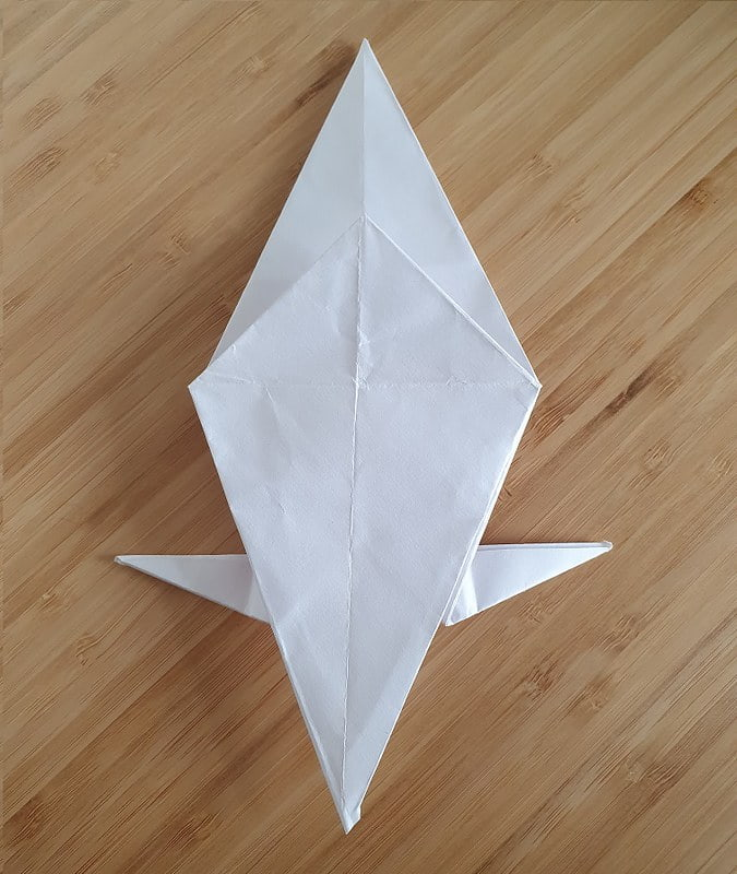 Step 5 to making an origami crow.