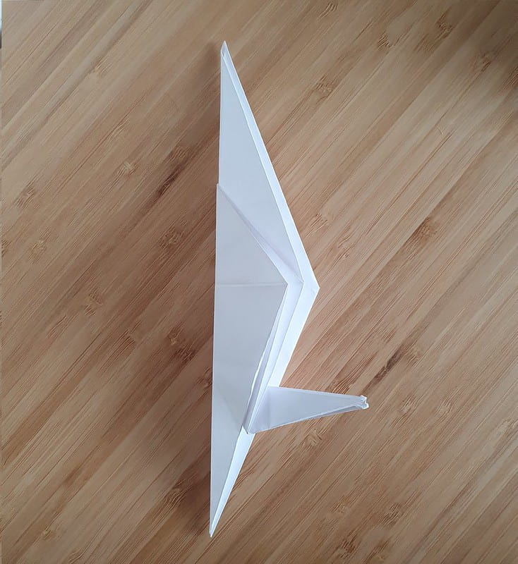 Step 6 to making an origami crow.