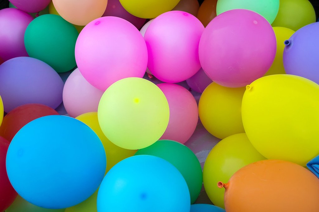 Lots of different coloured balloons.