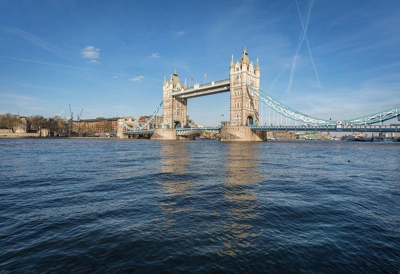 A full view of Tower Bridge from the River Thames.