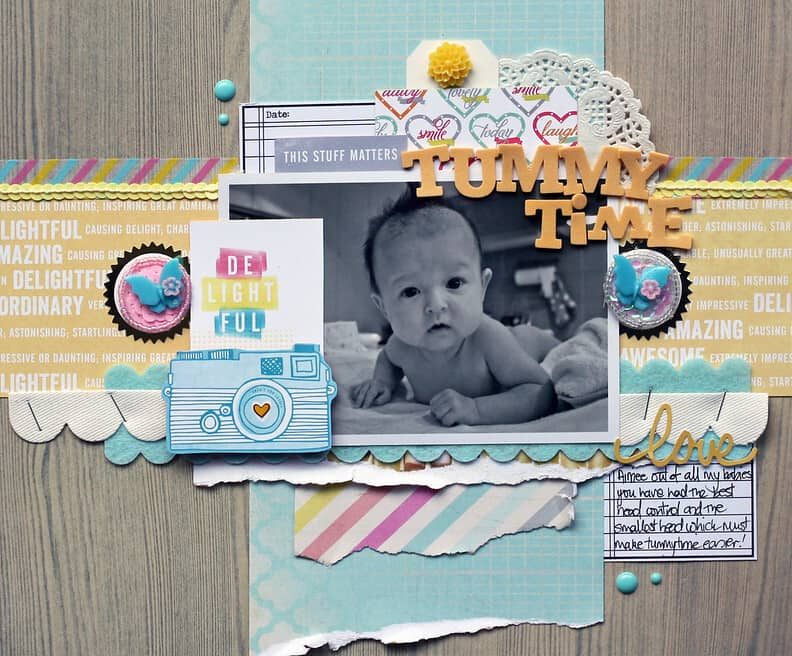 Baby scrapbook page about Tummy Time, decorated with stickers and photos.