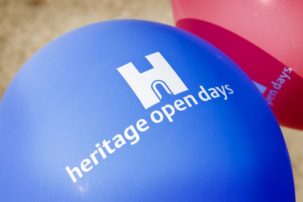 Heritage Open Days blue printed balloon with a red one next to it.