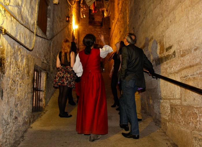 People walking through 17th century streets at The Real Mary King's Close.