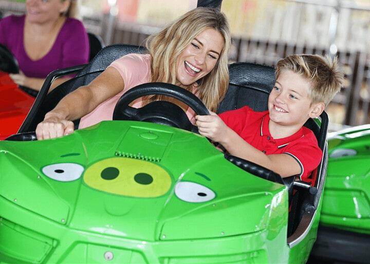 Mum and son in a dodgem car at King Pig's Wild Hog Dodgems.