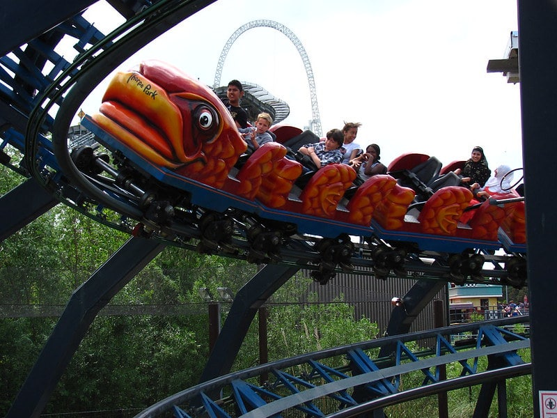 Kids and adults enjoying Flying Fish rollercoaster ride.