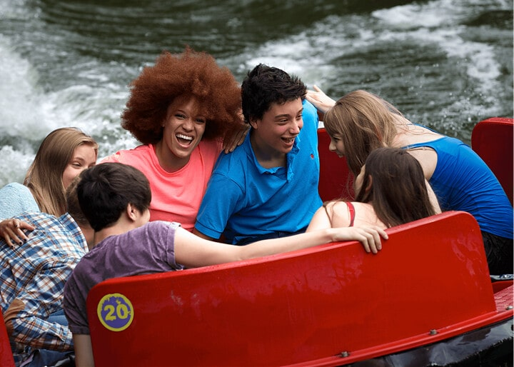 Friends and family enjoying the slopes in Rumba Rapids water ride.