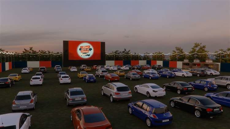 Cars lined up watching the big screen at Kent Drive In Cinema.