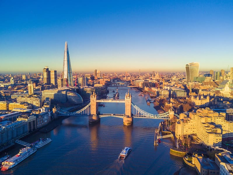 A panoramic view of the City of London with Tower Bridge as the central focus.